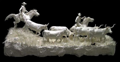 Esculturas hechas de papel fotográfico 10