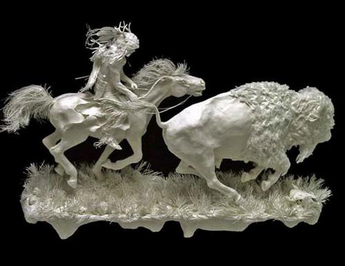 Esculturas hechas de papel fotográfico 12